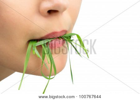 Woman With Wheatgrass In Her Mouth, Isolated On White.