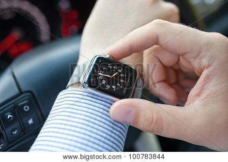 Man Hand In The Car With Apple Watch And Clock
