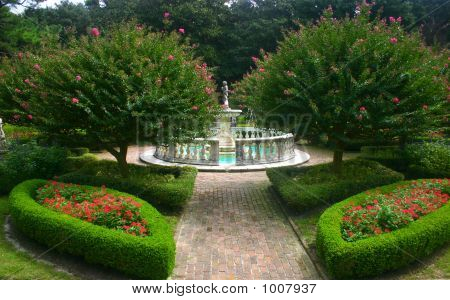 Lush Garden With Fountain