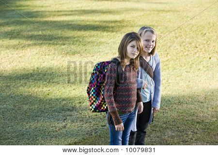 Children Carrying Backpacks Outdoors