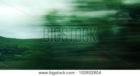 Defocused Trees Viewed Through A Car Windscreen.