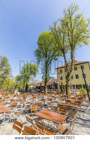 People Enjoy The  Hirschgarten Near Chinese Tower In English Garden In Munich