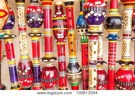 Wooden Colorful Flutes At The Street Market In Montenegro. Useful For Background.