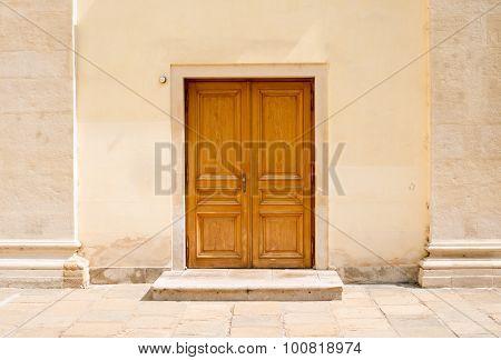 Wooden doors in wall