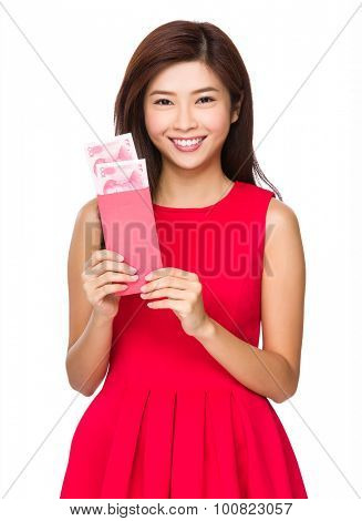 Chinese girl hold with red pocket with RMB