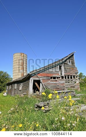 Deteriorating barn and silo