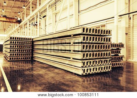 Stack of precast reinforced concrete slabs in a house-building factory workshop poster