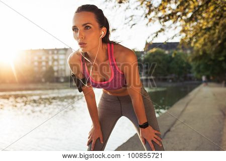 Young Sportswoman Resting After Run