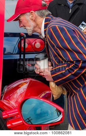 Old Man Admiring An Italian Sportscar
