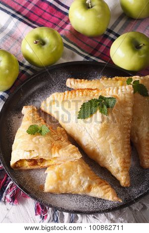 Homemade Turnover With Apple Stuffing Close-up On A Plate. Vertical