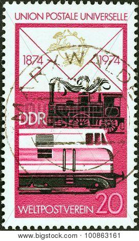 GERMAN DEMOCRATIC REPUBLIC - CIRCA 1974: Stamp shows Steam and diesel railway locomotives