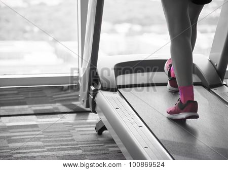 Woman Workout On Treadmil Split-tone