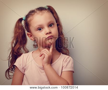 Fun annoyed kid girl thinking and looking serious about. Closeup vintage portrait poster