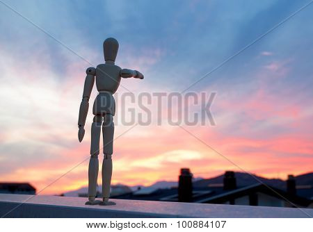Wooden Dummy Pointing With His Finger Towards The Horizon
