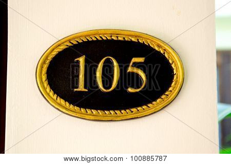 the room number 105 written on a sign
