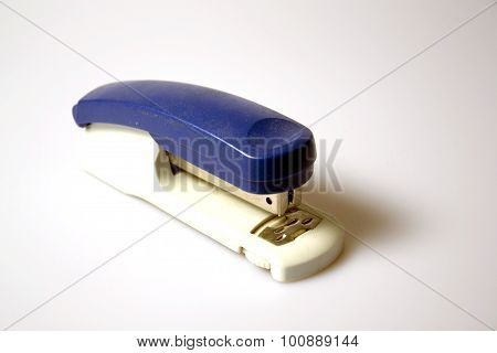 a blue stapler on a white background