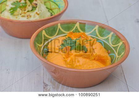 Orange Humus On A Wooden Table
