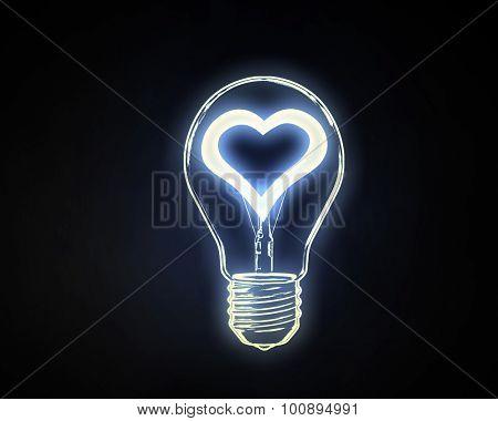 Lightbulb with glowing heart inside onn dark background