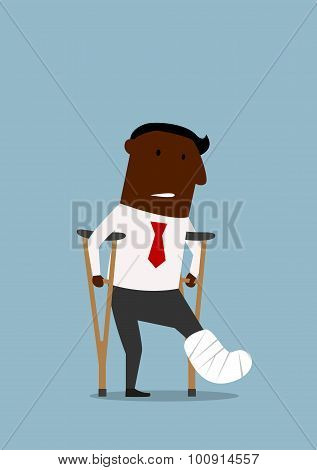 Black businessman with broken leg