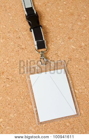 Blank Badge With Neckband On Corkboard Background.