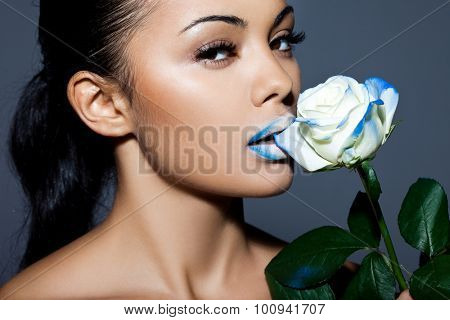 Beautiful woman with blue rose