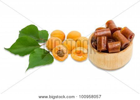 Apricot Pastila And Several Ripe Apricot On A Light Background