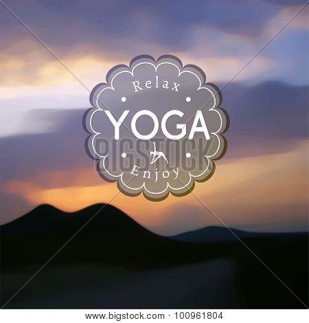 Name of yoga studio on a blurred hills background.