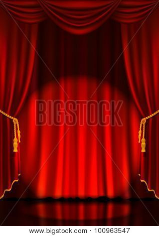 Theater stage with red curtain.