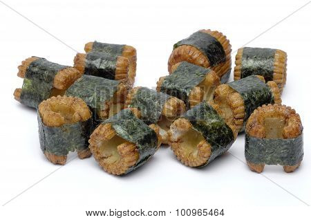 Sushi-shaped, Small Pastry Pieces, Wrapped With Seaweed, Seaweed, And A Strong Fishy Taste