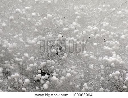 Grains of hail on ice