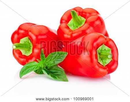 Three Bell Red Peppers With Green Leaves Basil Isolated On White Background