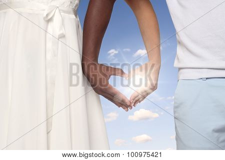 Couple Forming Heart Shaped Hands Together