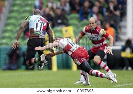 TWICKENHAM, ENGLAND. 17 SEPTEMBER 2011. Harlequins Ugo Monye, is tackled in the air by Gloucester's Charlie Sharples,  during the Aviva premiership rugby union match between Harlequins and Gloucester