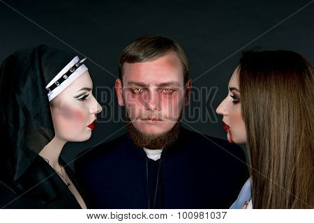 Halloween. A Man And Women Dressed As The Clergy