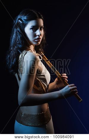 Sensuality beauty brunette with a wooden flute poster