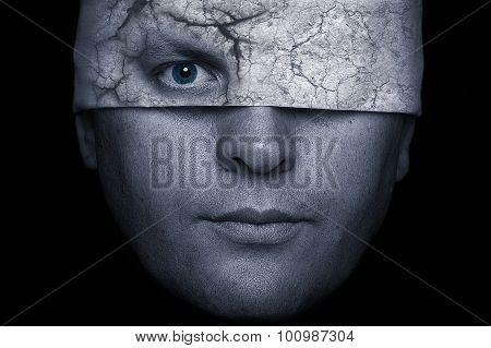 Face Of Man With Cracked Blindfold And Eye Looking Through