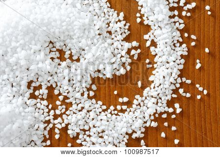 Coarse grained salt on wooden table