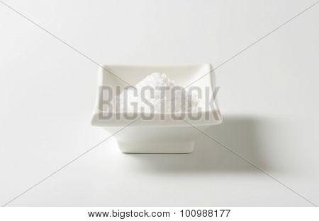 coarse ground salt in white rectangular bowl