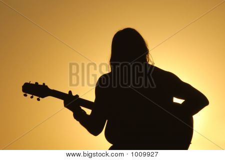 Guitar Man: Sunset Silhouette