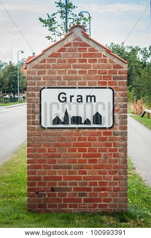 Gram City Sign On A Brick Post