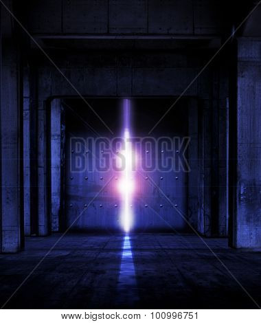 Heavy steel doors opening. Large steel doors at the end of a dark corridor, opening and light coming in.