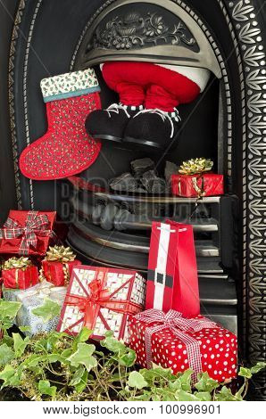 Father Christmas delivering Gifts
