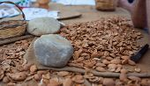 Close up of stone and many blanched almonds poster
