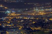 night view of the populous European metropolis with many city lights poster