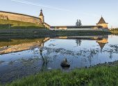 The City Of Pskov. Russia. Pskov Kremlin from the side of the Pskova river at sunrise. poster