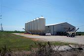 LISBON, ILLINOIS / UNITED STATES - AUGUST 2, 2015: The Grainco FS, Inc. Bulk Seed and Treatment Facility offers graincoat seed treatment at its Lisbon Center facility. poster