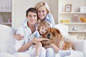 A young family wiht children at home poster