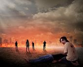 Creepy zombie eat dead man flesh with city on fire background poster