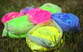 Bags with Indian dyes on Holi color festival poster