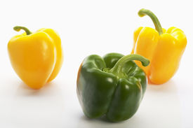 Three colourful peppers on the white background